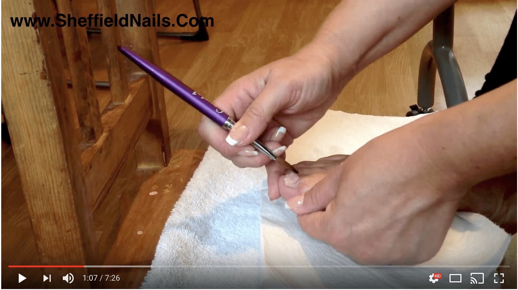 Applying acrylic adhesive on toenails